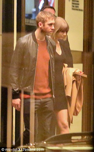Date night: Calvin also opted for a casual ensemble in a red top and black jeans while he also donned a black leather jacket