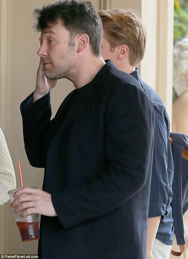 Weary: Ben Affleck looked a bit tired as he was spotted heading into theFour Seasons in Beverly Hills on Tuesday after exes Jennifer Garner and Jennifer Lopez mocked his new back tattoo