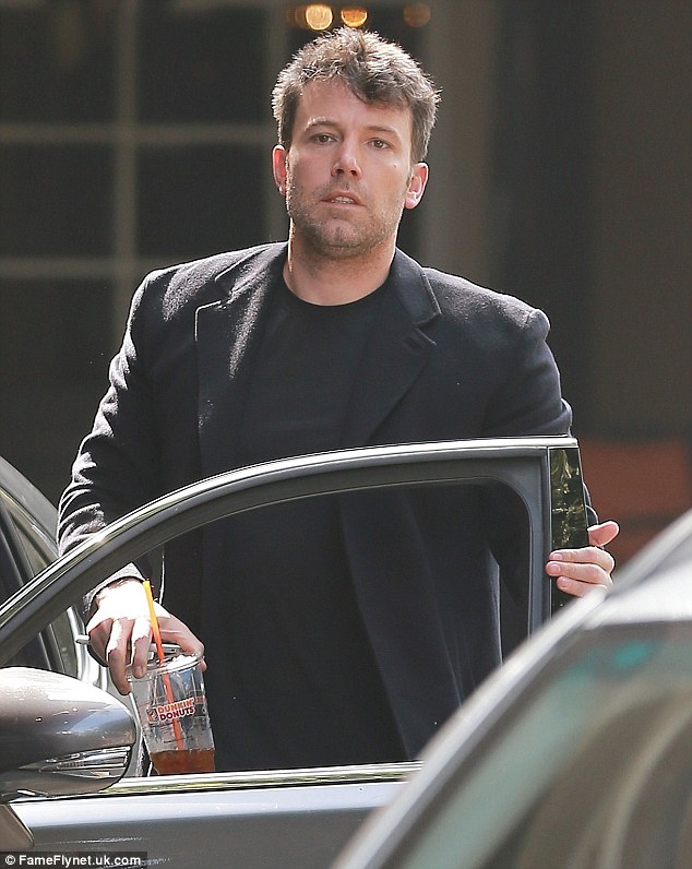 A pick-me-up: The Oscar winner was spotted carrying a large iced beverage from Dunkin' Donuts as he arrived