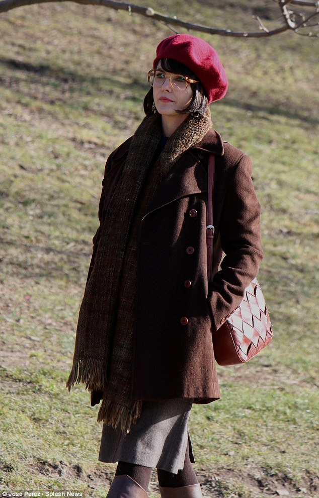 Disguised: Russell is four months pregnant but the pregnancy is not being written into the show. A baggy coat and a woolen scarf helped hide her baby bump while filming