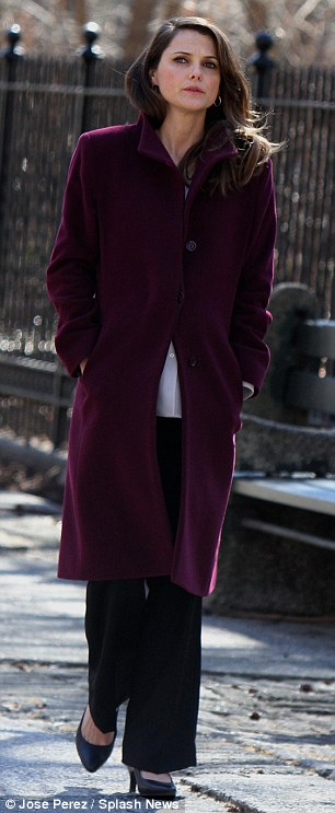Strategic costume: In another scene Tuesday, the actress wore a long coat over wide-legged trousers to hide her pregnancy