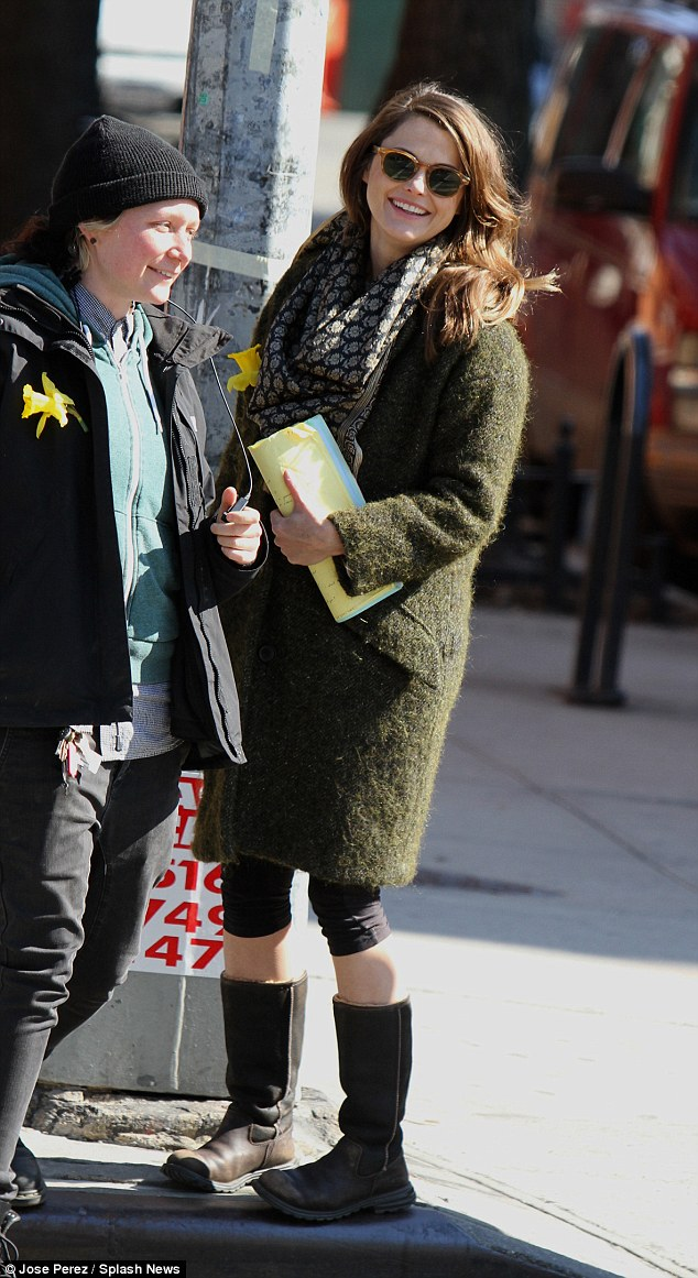 Dressed down: Before shooting her scenes, Russell was spotted chatting with a crew member while wearing cropped leggings with boots and a fluffy green coat