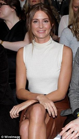 Still smiling: The brunette was noticeably no longer wearing her wedding ring on her left hand