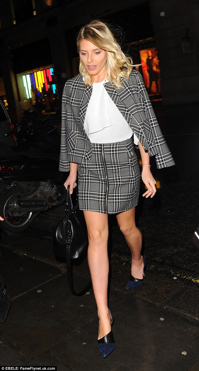 Best foot forward: The Saturdays singer went bare-legged under her checked miniskirt, setting off the look with navy suede heels