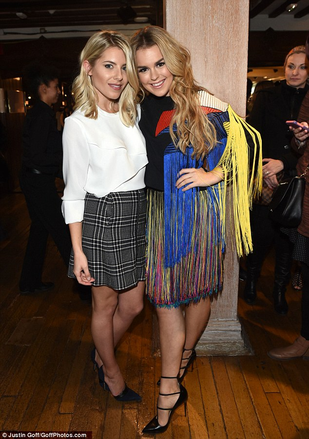 Party pals: The blonde beauty cosied up to fellow singer Tallia Storm at the fundraiser