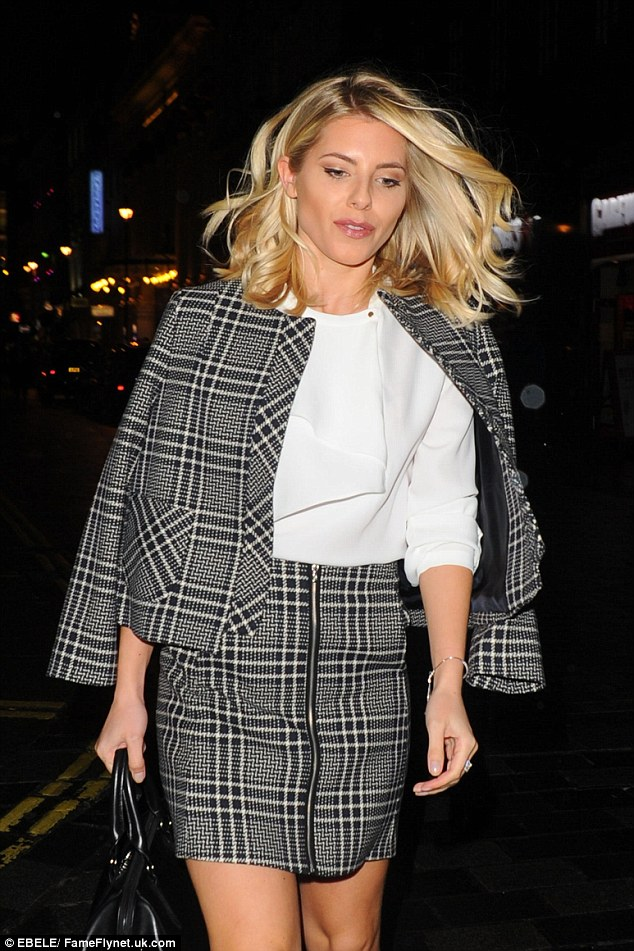 Demure: Mollie carried a leather handbag and set off her look with simple silver jewellery