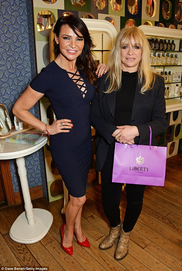 Unlikely friends: Lizzie Cundy chatted to Jo Wood at the star-studded event