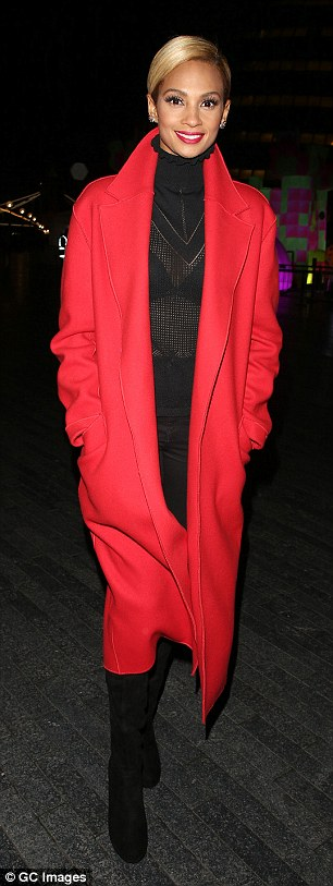 Lady in red! Alicia instilled a splash of colour into the monochromatic look with a vivid red duster coat, a perfect match with the striking red lipstick she modelled