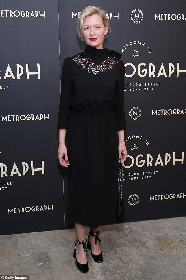 A touch of lace: Gretchen wore a black lace-accented vintage-inspired number
