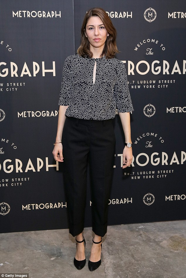 Work of art: Sofia Coppola looked comfortable yet chic in a busy-patterned blouse and trouser ensemble