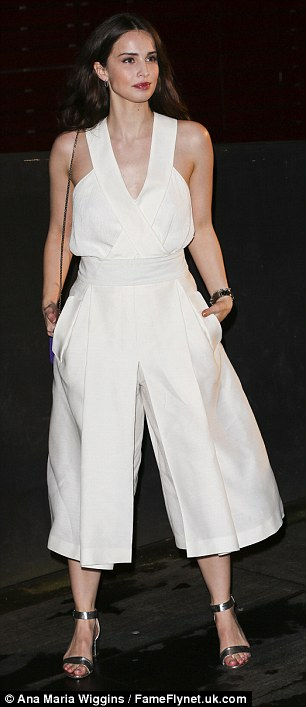 Strike a pose: The actress showed off her statement jumpsuit and silver heels as she posed outside