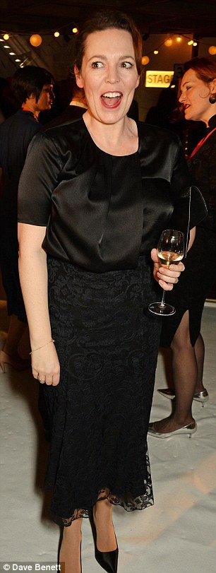 Gorgeous! Olivia opted for a demure black gown which was rendered in an alluring silk fabric around the torso before trailing into a black lace skirt, which conceded conservatively below the knee
