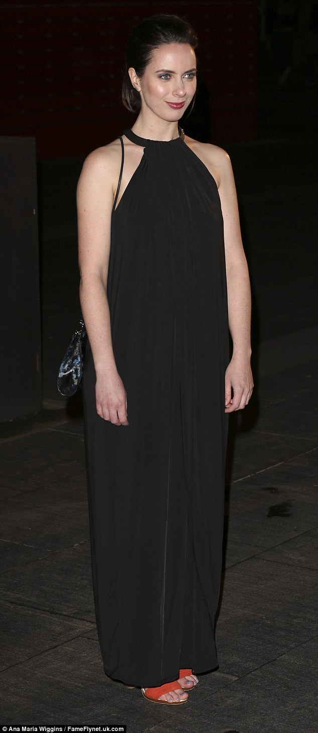 Glam: Stage and screen starKate O'Flynn added a pop of colour to her black ensemble with orange heels