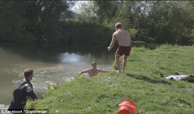 Making a splash: James got the shock of his life when he slipped off the bank and into the lake