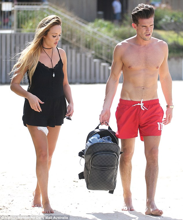Side by side: Charlotte and Gary topped up their tans during a day out at the popular Sydney beach on Wednesday