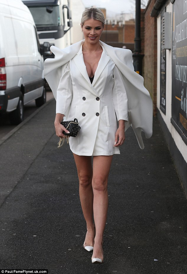 Caped crusader: Chloe Sims ripped up the rule book, flashing both her eye-popping cleavage and lean limbs in a white blazer dress as she headed to TOWIE filming in Essex on Wednesday
