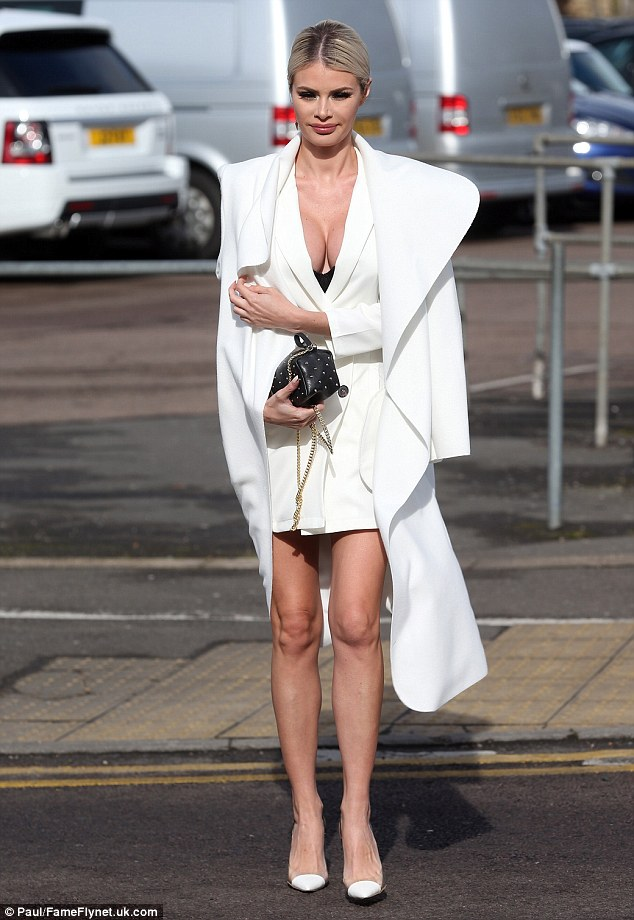 Busting out: The beauty salon owner looked close to spilling out of the plunging garment as she headed to The Sugar Hut in Brentwood where the ITVBe cast filmed a Mother's Day special