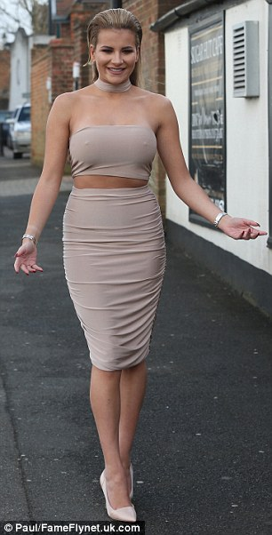 Nipping out: Georgia Kousoulou followed Chloe's skin-showing lead in nude bodycon co-ords through which her nipples poked out