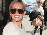 Los Angeles, CA - A happy Hilary Duff arrives with a smile for the cameras with a friend at Los Angeles international airport for a flight out of town.   AKM-GSI March  1, 2016 To License These Photos, Please Contact : Steve Ginsburg (310) 505-8447 (323) 423-9397 steve@akmgsi.com sales@akmgsi.com or Maria Buda (917) 242-1505 mbuda@akmgsi.com ginsburgspalyinc@gmail.com