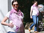 Exclusive... 51984548 Pregnant Anne Hathaway shows off her massive baby bump while out for a stroll in Los Angeles, California on March 1, 2016. Anne is expecting her first child with husband Adam Shulman FameFlynet, Inc - Beverly Hills, CA, USA - +1 (310) 505-9876