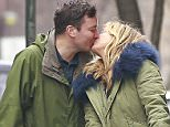 02/29/2016 EXCLUSIVE: Jimmy Fallon and wife Nancy Juvonen kiss on the street while out for a walk with kids Winnie and Frances Fallon in New York City. The happy family also greeted firefighters when a firetruck passed them by. Please byline:TheImageDirect.com
