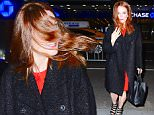 """Julianne Moore was spotted arriving to Radio City Music Hall for """"Im With Her"""" a concert benefitting Hillary Clinton's Presidential Campaign. She was a vision in Red as she made her stylish entrance. But a large wind gust sent her hair into a wild mess. She quickly brushed it out of her face, restoring her perfect image.\n\nPictured: Julianne Moore\nRef: SPL1239797  020316  \nPicture by: 247PAPS.TV / Splash News\n\nSplash News and Pictures\nLos Angeles: 310-821-2666\nNew York: 212-619-2666\nLondon: 870-934-2666\nphotodesk@splashnews.com\n"""