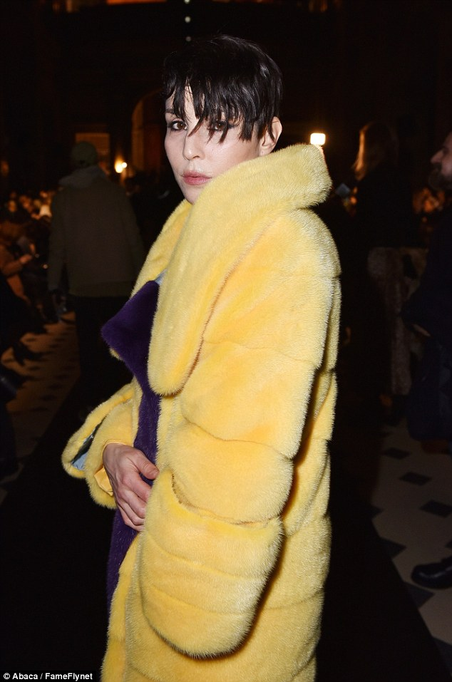 Fashion fan: The 36-year-old was hard to miss as she rocked the bright outerwear over a matching yellow trouser suit