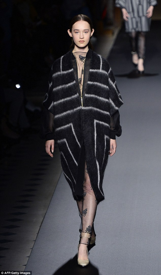 High fashion: The models also sported oversized jackets and striped co-ord looks