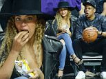 2.March.2016 - Los Angeles ? USA\n*** STRICTLY AVAILABLE FOR UK AND GERMANY USE ONLY ***\nLos Angeles, CA - Beyonce and Jay Z munch on some Lay's Potato Chips as they sit court side at the Los Angeles Clippers vs. Oklahoma City Thunder game at the Staples Center in Los Angeles, California\nBYLINE MUST READ : AKM-GSI-XPOSURE\n***UK CLIENTS - PICTURES CONTAINING CHILDREN PLEASE PIXELATE FACE PRIOR TO PUBLICATION ***\n*UK CLIENTS MUST CALL PRIOR TO TV OR ONLINE USAGE PLEASE TELEPHONE 0208 344 2007*