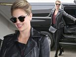 *EXCLUSIVE* Los Angeles, CA - Kate Upton departs from LAX Airport after wearing a show stopping revealing dress last night on the red carpet for the Vanity Fair party.\nAKM-GSI          October 29, 2016\nTo License These Photos, Please Contact :\nSteve Ginsburg\n(310) 505-8447\n(323) 423-9397\nsteve@akmgsi.com\nsales@akmgsi.com\nor\nMaria Buda\n(917) 242-1505\nmbuda@akmgsi.com\nginsburgspalyinc@gmail.com