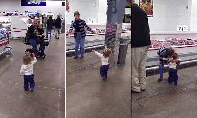 Toddler Joelle is so happy she uses trip to supermarket to dish out hugs to shoppers