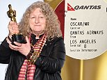 """HOLLYWOOD, CA - FEBRUARY 28:  Costume designer Jenny Beavan, winner of the Best Costume Design award for """"Mad Max: Fury Road,"""" poses in the press room during the 88th Annual Academy Awards at Loews Hollywood Hotel on February 28, 2016 in Hollywood, California.  (Photo by Jeff Kravitz/FilmMagic)"""