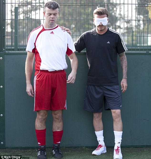 David Clarke, pictured with David Beckham, is a footballer who has been visually impaired since he was born