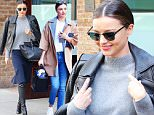Model Miranda Kerr steps out in a style outfit in New York City, she was wearing a blue skirt with a grey top and leather knee high boots and matching jacket over her shoulders  as carrying her Celine bag\n\nPictured: Miranda Kerr\nRef: SPL1239932  030316  \nPicture by: Felipe Ramales / Splash News\n\nSplash News and Pictures\nLos Angeles: 310-821-2666\nNew York: 212-619-2666\nLondon: 870-934-2666\nphotodesk@splashnews.com\n