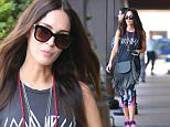 """Tuesday, March 1, 2016 - Megan Fox sports rocker chic exercise gear and a fringe black handbag as she leaves SoulCycle in Brentwood, CA. Fox sports a tank top with the text """"Good Vibes"""" on it. Green/X17online.com"""