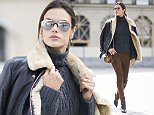 PARIS, FRANCE - MARCH 02:  Alessandra Ambrosio is wearing a coat from Acne a sweater from Calvin Rucker, Magda Butrym suede pants, Gianvito Rossi boots, Linda farrow sunglasses and a bag from Chloe  seen in the streets of Paris during the Paris Fashion Week Womenswear Fall/Winter 2016/2017 on March 2, 2016 in Paris, France.  (Photo by Timur Emek/Getty Images)