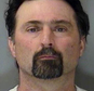 """FILE - This undated file photo provided by the Yellowstone County Detention Facility shows William Krisstofer Wolf. Wolf, convicted of seeking out high-powered weaponry for the """"second American revolution"""" faces sentencing in federal court. Prosecutors are seeking 10 years in prison for Wolf, who bought an automatic shotgun from an FBI agent in an undercover sting and talked of targeting judges, elected officials and law enforcement. (Yellowstone County Detention Facility/The Billings Gazette via AP, File) MANDATORY CREDIT"""
