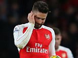 LONDON, ENGLAND - MARCH 02 :  A dejected Olivier Giroud of Arsenal walks back with Mesut Ozil of Arsenal after Swansea City score to make it 1-2 during the Barclays Premier League match between Arsenal and Swansea City at the Emirates Stadium on March 02, 2016 in London, England.  (Photo by Catherine Ivill - AMA/Getty Images)