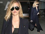 New York, NY - Khloe Kardahian arrives to LAX trying to be incognito in an all black outfit to no avail. The KUWTK reality star wore her oversized sunglasses at night, a long satin lined trenchcoat, and a black pantsuit.  AKM-GSI       January 21, 2016 To License These Photos, Please Contact : Steve Ginsburg (310) 505-8447 (323) 423-9397 steve@akmgsi.com sales@akmgsi.com or Maria Buda (917) 242-1505 mbuda@akmgsi.com ginsburgspalyinc@gmail.com