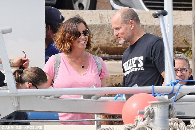 Old friends: Alanis and Woody, who have been pals for years, shared a laugh as they waited to set sail