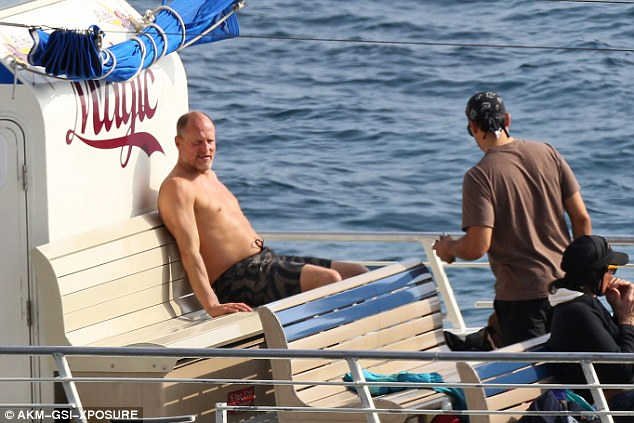 Kicking back: The star later basked in the sunshine on board the sightseeing boat