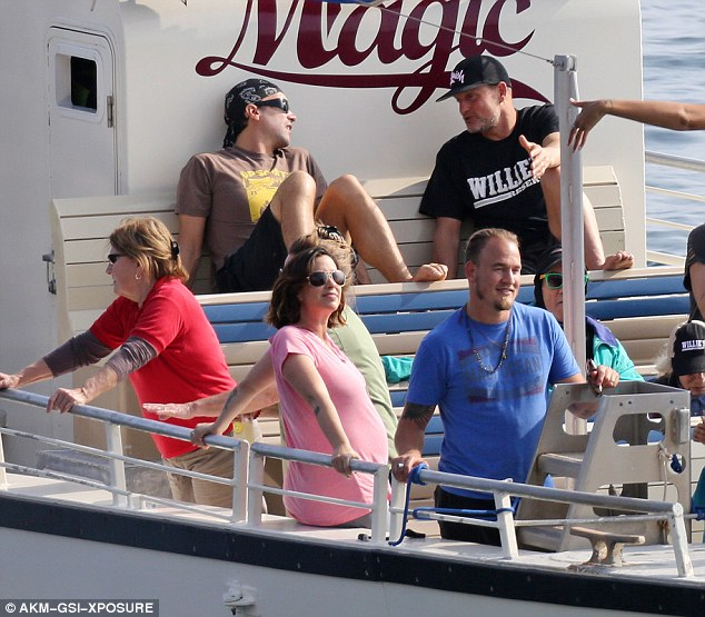 Parents again: Alanis looked completely relaxed as she enjoyed the tour with her husband Mario by her side