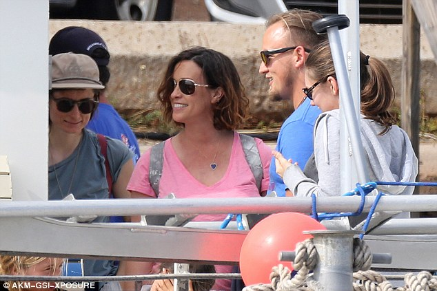 Natural beauty: Alanis sported a bright pink t-shirt and shades as the group set sail