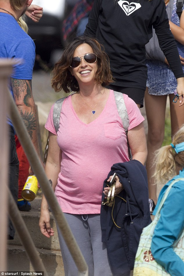Pretty in pink: The singer looked gorgeous as she set off for the fun day out