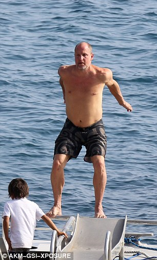 Action man: The star, who sticks to a strict raw veganism diet, looked in great shape as he stripped down to his swim shorts