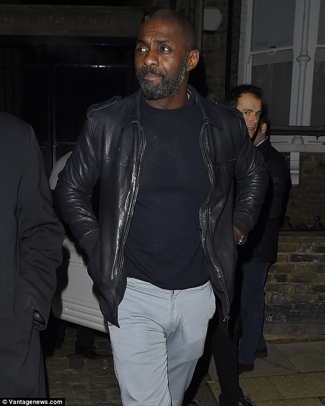 Cool customer: The award-winning Luther actor was typically styled in light blue suit trousers, a black jumper and a leather jacket