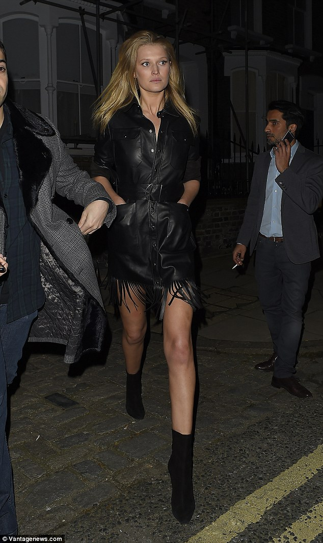 Stunning: Model Toni Gaarn flaunted her incredible legs in a leather mini dress with fringed detailing