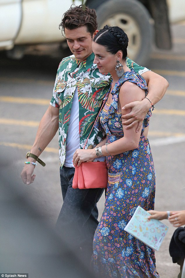 Taking a break: The genetically-blessed duo looked smitten with one another as they spent the day hiking with pals at Nā Pali Coast State Park in Kauai last Saturday, before cosying up ahead of a dreamy dinner date the following day
