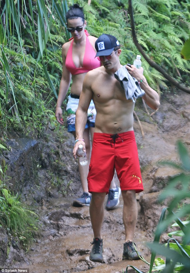 Working up a sweat: The twosome showcased their love of the outdoors as they hiked around the island