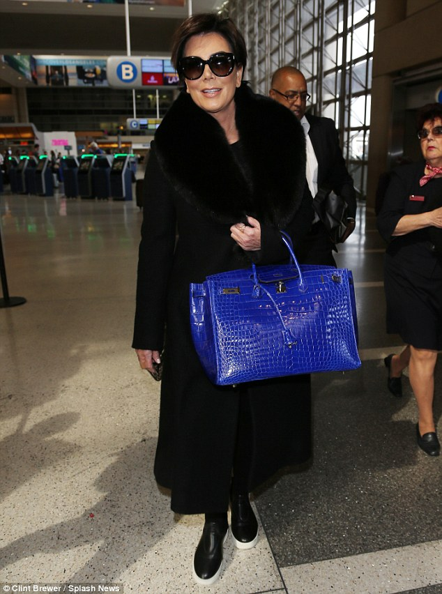 Traveling in style! Kris Jenner, 60, flew out of LAX airport on Wednesday with her beloved blue Hermes Birkin bag